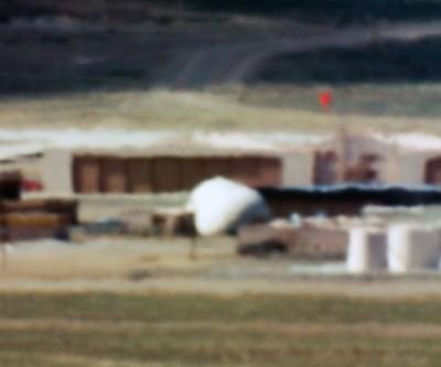 Limit Telephotography: Gallery, San Francisco; Large Hangars and Fuel Storage / Tonopah Test Range, NV/ Distance ~ 18 miles/ 10:44 am (2005)