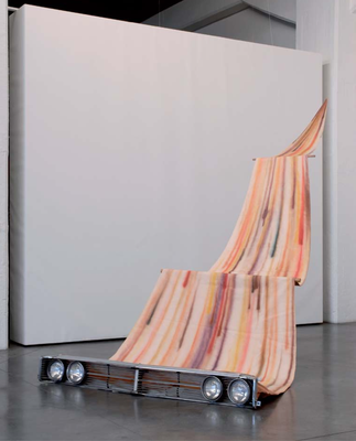 A striped stain painting that zig zagged from the ceiling of Praz-Delavallade widening to attach into a 60 car grille on the floor... (1999)